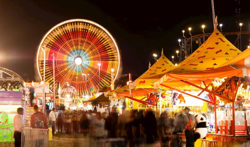 festival-goers enjoy carnival rides at the Fellsmere Frog Leg Festival