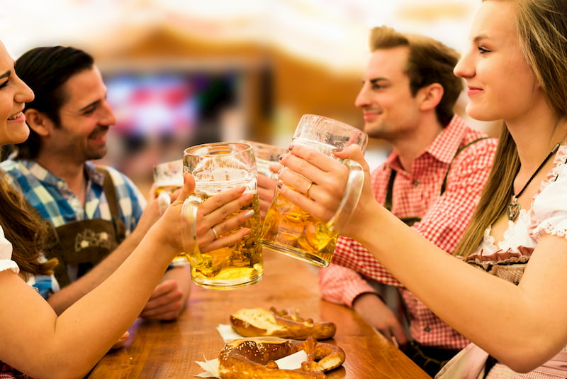 friends toast and enjoy a few beers at Oktoberfest in Lantana