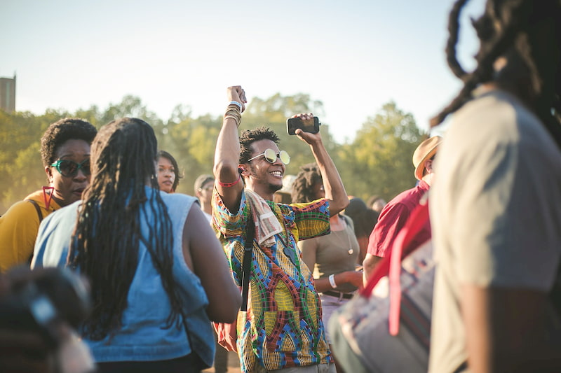 man dances in a festival crowd