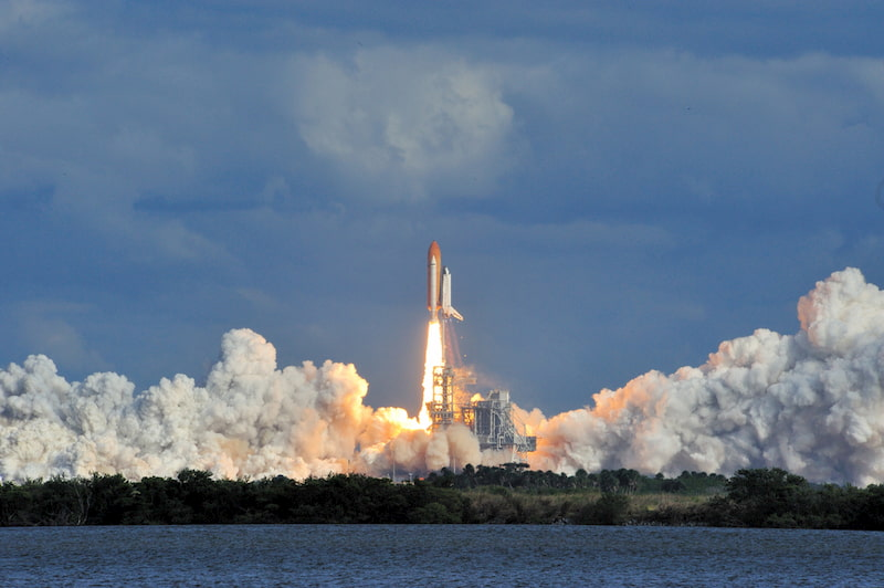 a rocket launches into space from the kennedy space center