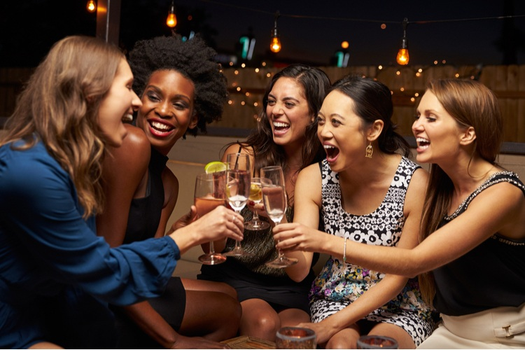 group of women enjoying drinks at an event