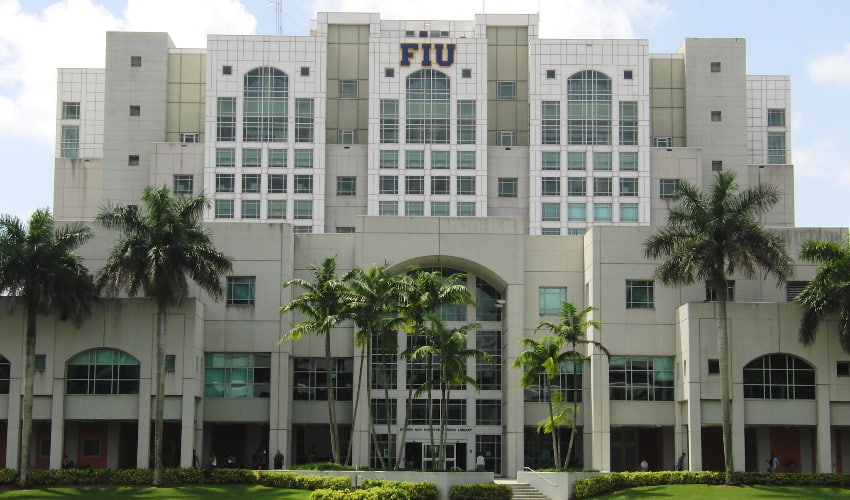 academic building at florida international university surrounded by palm trees