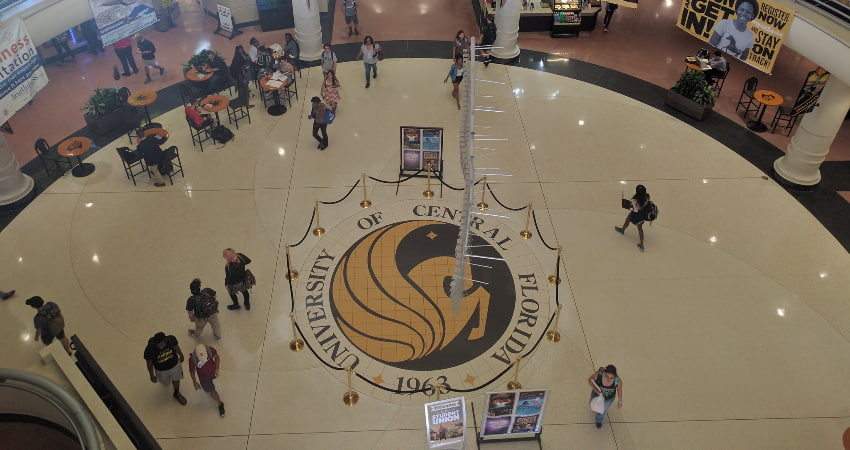 interior of the UCF student union with pegasus medallion in center of floor