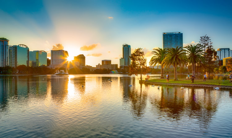 The Orlando city skyline over Lake Eola during sunset