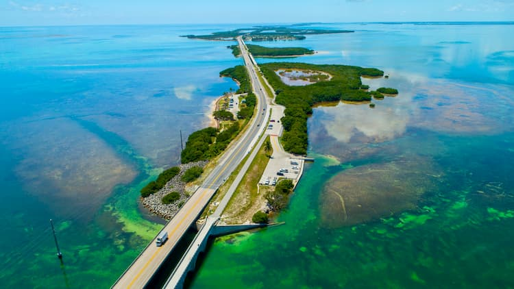 Florida key west highway surrounded by blue green water and islands