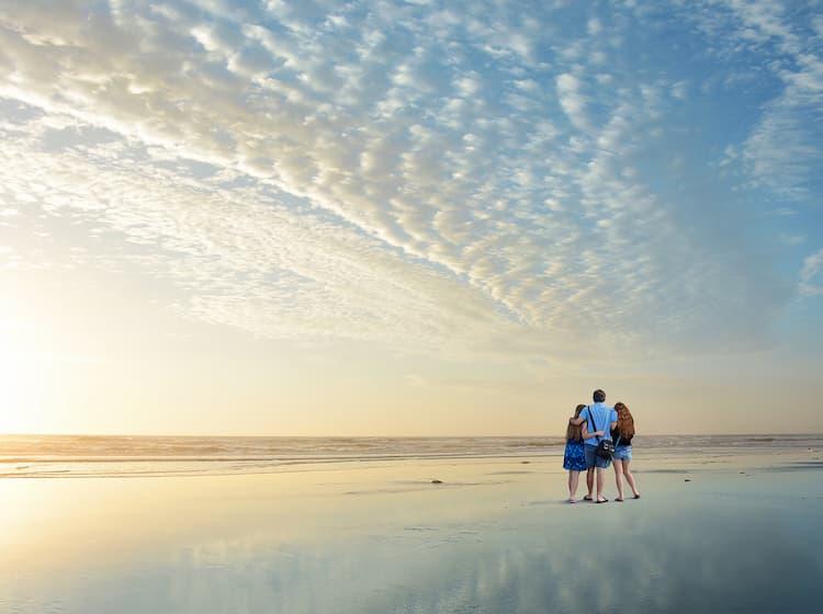 Family enjoying time on the beach in Jacksonville, Florida at sunrise