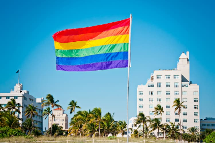 Rainbow flag in front of buildings in Miami Beach
