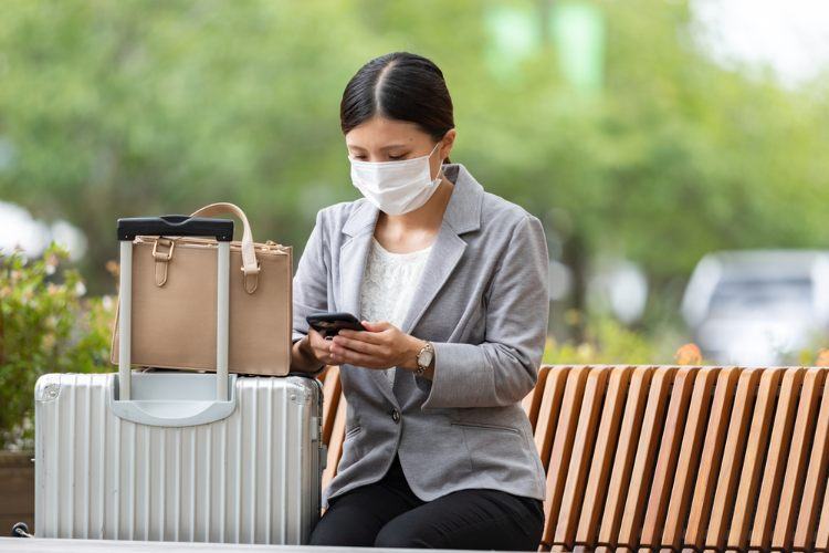 Woman traveling for work with mask