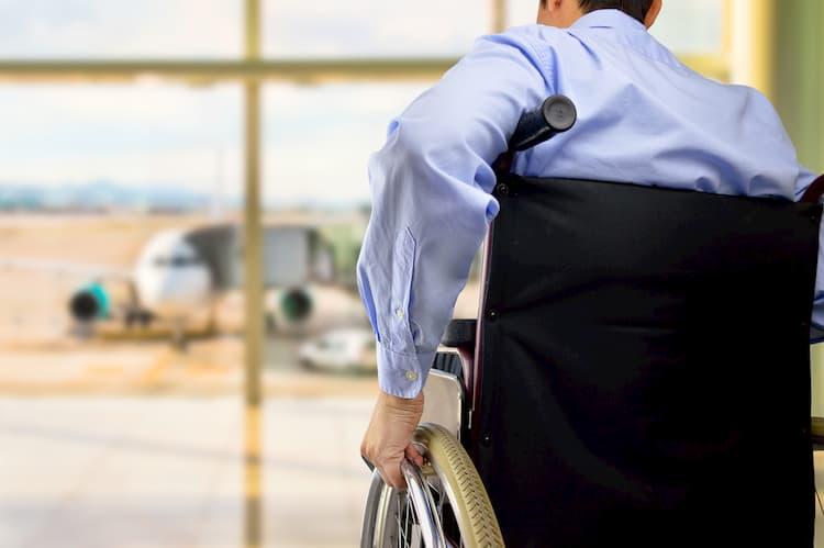 Businessman using wheelchair at airport