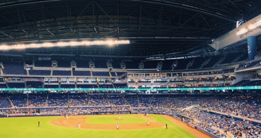 A photo inside Marlins Park during a baseball game, looking out over the outfield and across the stands full of fans