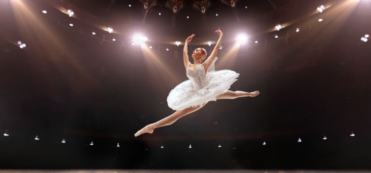 a ballerina jumps in the air and splits her legs