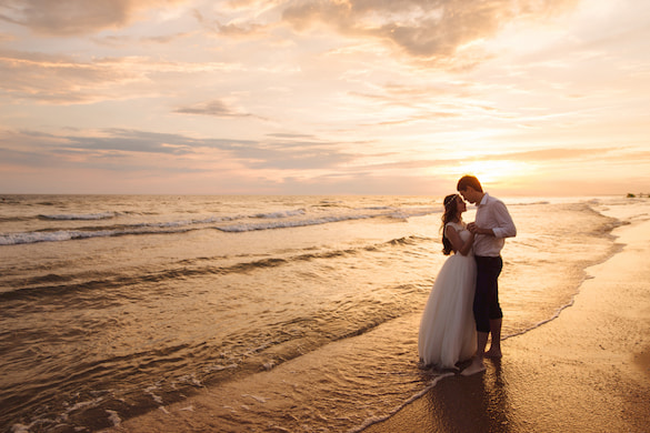 a couple kiss at sunset on the beach