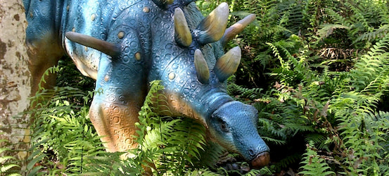 a life-sized stegosaurus statue at Dinosaur World in Tampa